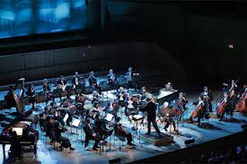 The orchestra and soloists at the Concert In Athens.