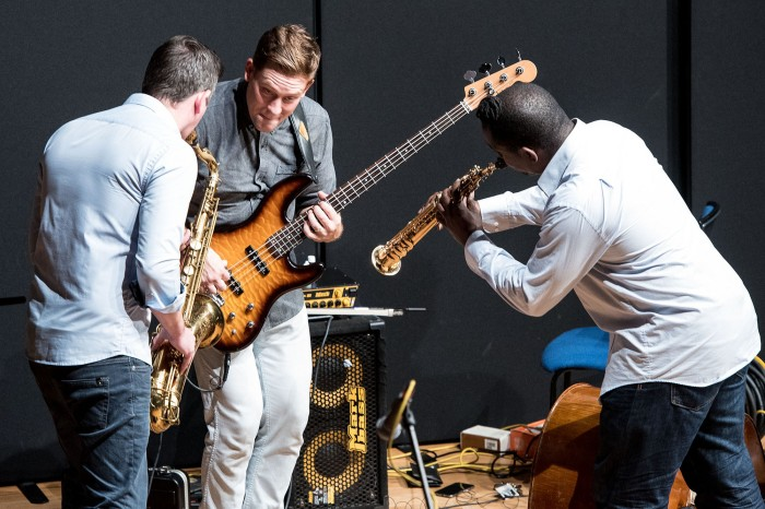 Saxophonists Paul Booth and Jason Yarde have some fun with bassist Michael Janisch during the concert at Birmingham Conservatoire. (Photo John Watson/jazzcamera.co.uk)